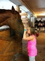That great love between a child and a horse <3 Charline with one of the horses in her Camp last summer :)