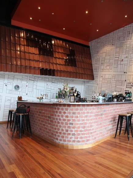 Cafe interior, Common Man, exposed red brick - wonder how this would look in a home kitchen?