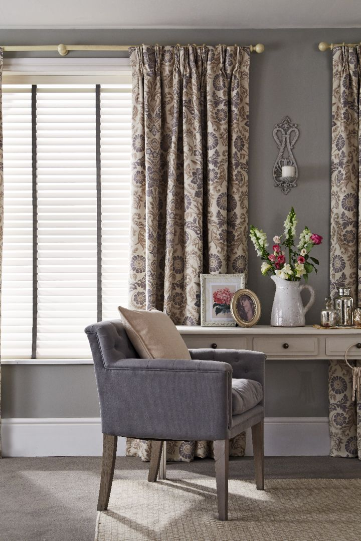 venetian blinds look stunning when layered with curtains this