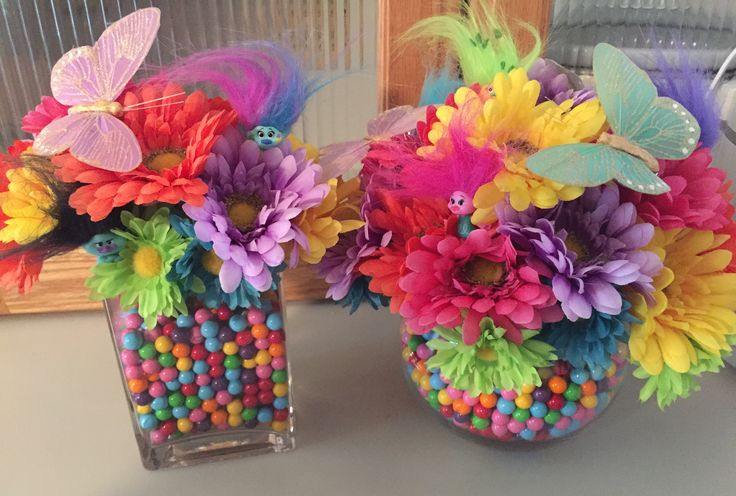 Troll party ideas! Colorful flower centerpiece! The vases are filled with sixlets.