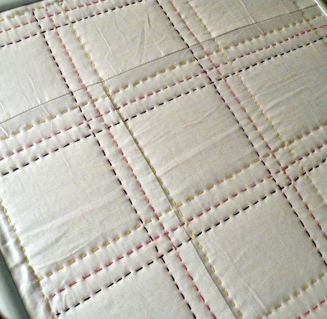 colored thread. So many possibilities. White with thread as the only color on the quilt. Neons?