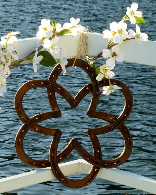Cowboy Wedding Rose... O my I have to have a couple of these made! So cool to hang outside above the print door! Or garage