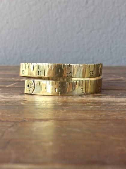 Perfect for the crafting-sewing friend!  Brass tape measure bracelet from redinfred