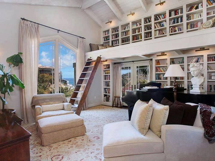 I like the big window in the library, although I am not totally sold on the room being all white. I like the reading loft.