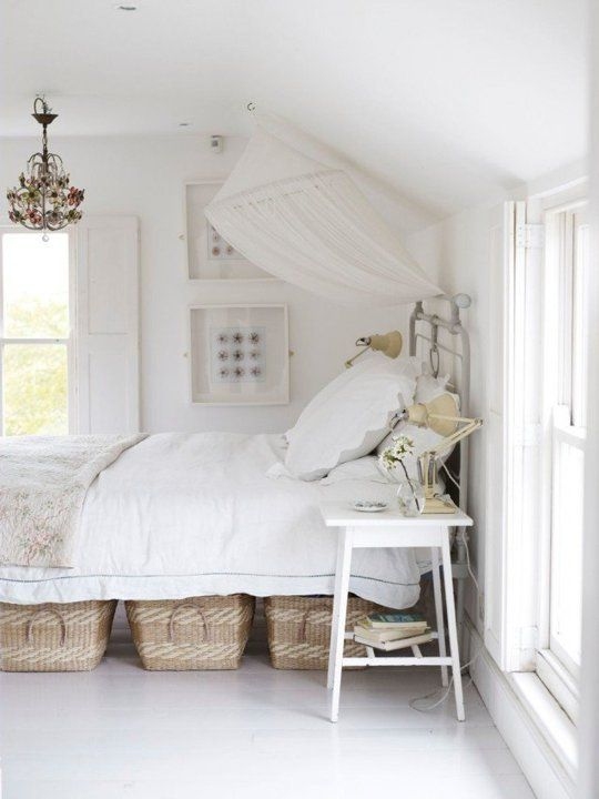 The under-bed baskets look better than big plastic bins. | 11 Ways to Squeeze a Little Extra Storage Out of a Small Bedroom | Tiny Homes