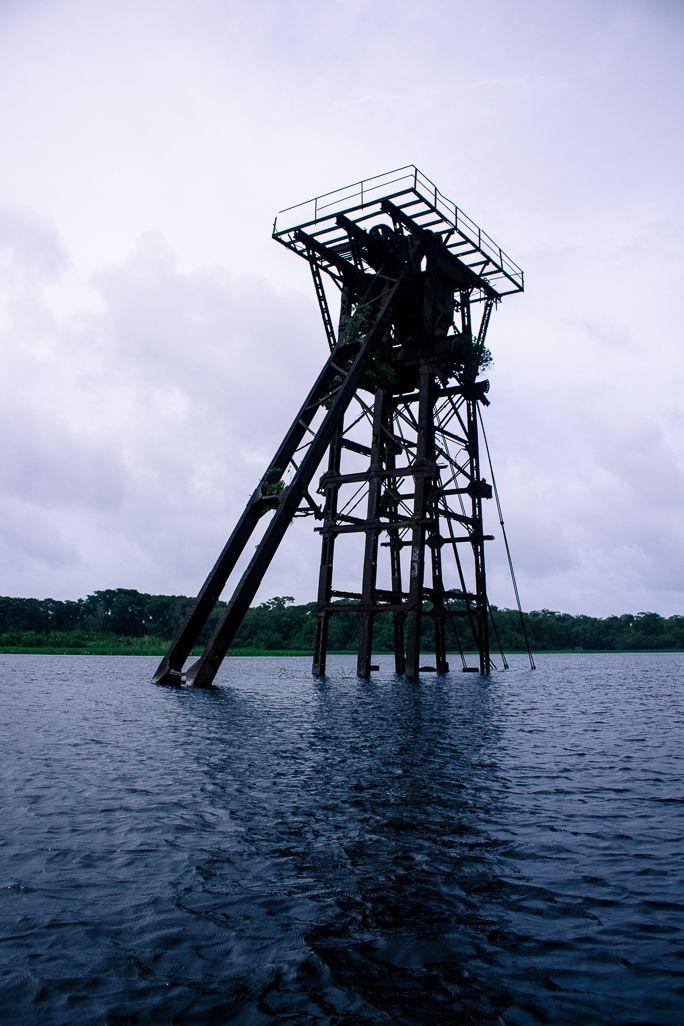 This tower stands abandoned in Rio San Juan, near San Juan de Nicaragua. It was for building a canal which was never built. Read more: http://www.bizarreglobehopper.com/blog/2014/09/08/san-juan-de-nicaragua-indio-maiz/