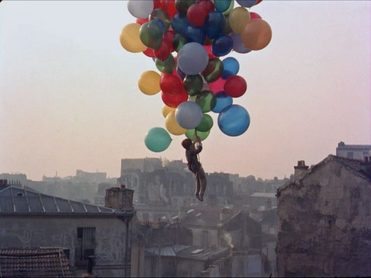 Le Ballon Rouge (The Red Balloon) by Albert Lamorisse...set in Paris. One of my favorite foreign films of all time.