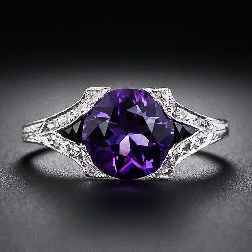 An entrancing deep purple faceted amethyst, dramatically accented with black onyx calibre and embellished with tiny twinkling diamonds, glows from within a recently made platinum ring created to emulate 1920s Art Deco jewels. An enchanting beauty. At Lang Antiques.