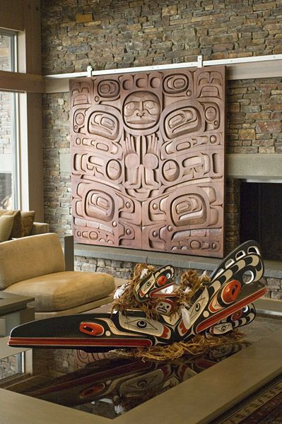 NATIVE ART CONSULTATION SERVICES In the background a stained cedar sliding panel custom designed by Rande Cook, covers an entertainment center. The Gallery serves as a liaison with acclaimed Native artists, like Rande Cook, to commission specialized pieces and offer unique design solutions