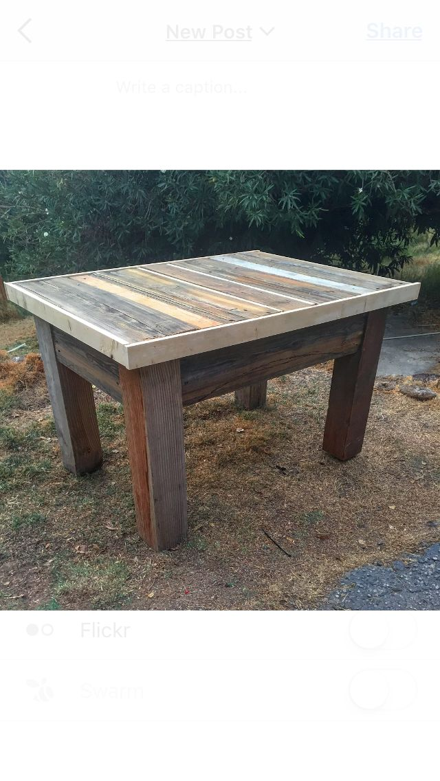 Handmade kitchen island table built  from old fashioned barns, farm structures, and ranch fences. 100% recycled materials.