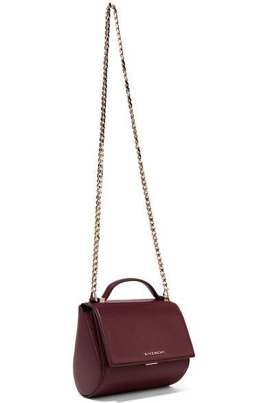 Givenchy's 'Pandora Box' bag is one of the label's most coveted styles. Meticulously crafted in Italy from burgundy textured-leather, this structured piece has a suede-lined interior sized to hold your cell phone, wallet and cosmetics. Carry it by the top handle or gold chain shoulder strap.