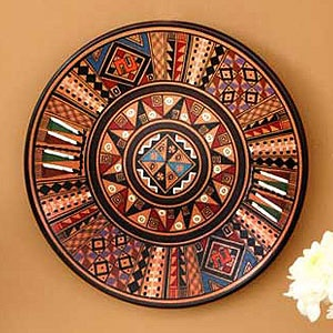 "Inca Star Cuzco Plate for Novica. Huaman Paucar Family says, ""Our clay pieces are molded both on an old-fashioned potter's wheel and by hand. Our art represents the history and customs of our village and its religious beliefs."""