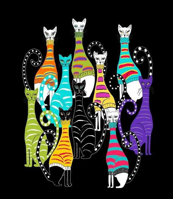 Cats in colorful turtleneck sweaters.