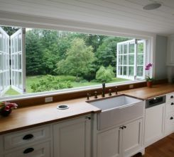 Wow - an entire kitchen wall of windows that open up.  Marvelous.