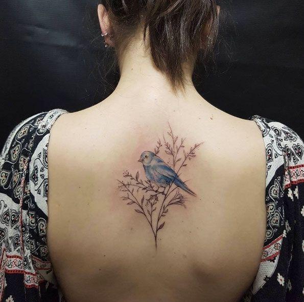 Bluebird tattoo on back by Otavio Borges