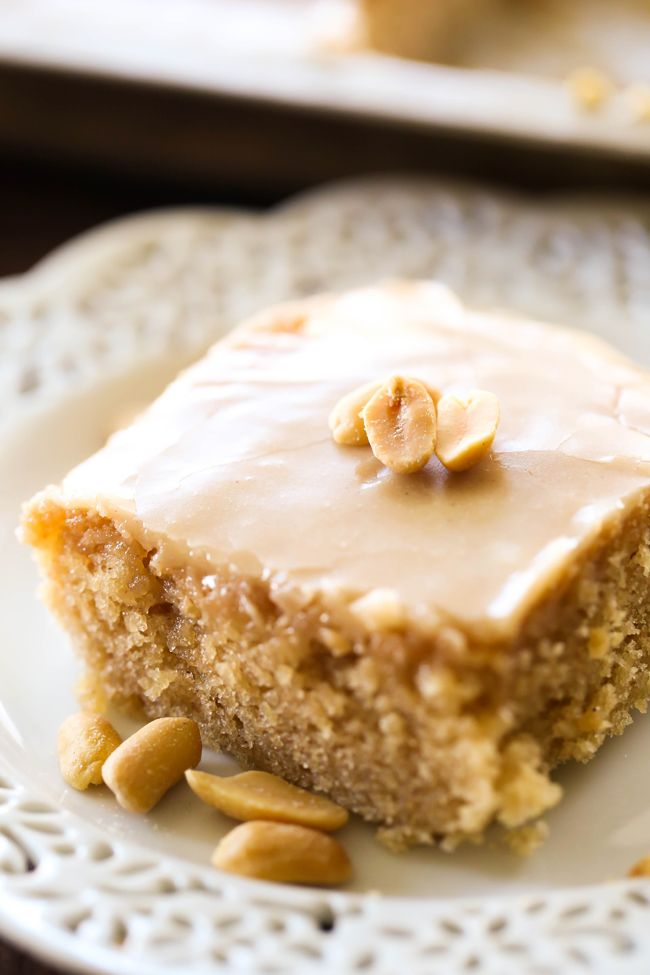 Peanut Butter Sheet Cake - If you love peanut butter, then you absolutely need to try this MELT-IN-YOUR-MOUTH Peanut Butter Sheet Cake. It is truly amazing!
