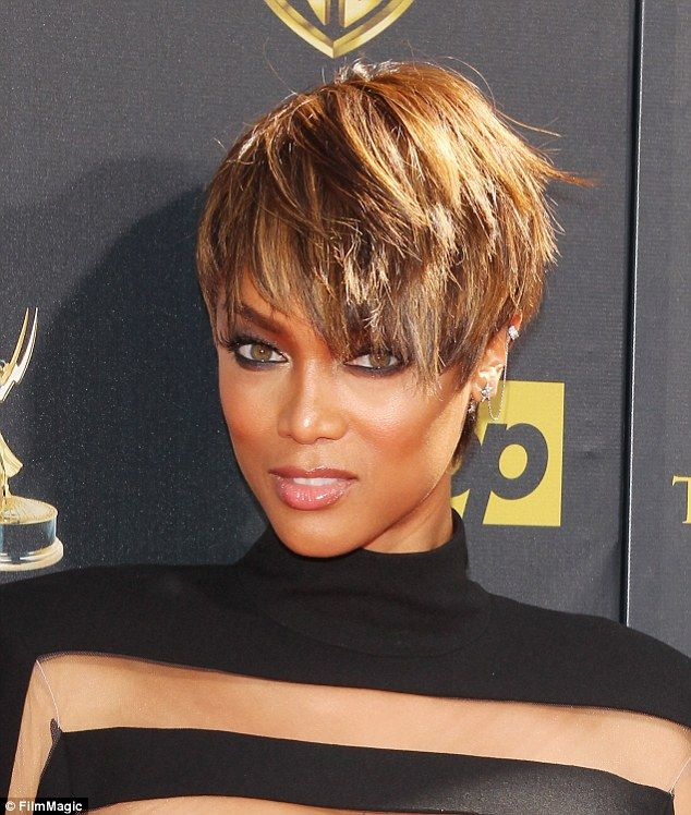 Her public face: The 41-year-old wore her more usual full war paint for the Daytime Emmy A...