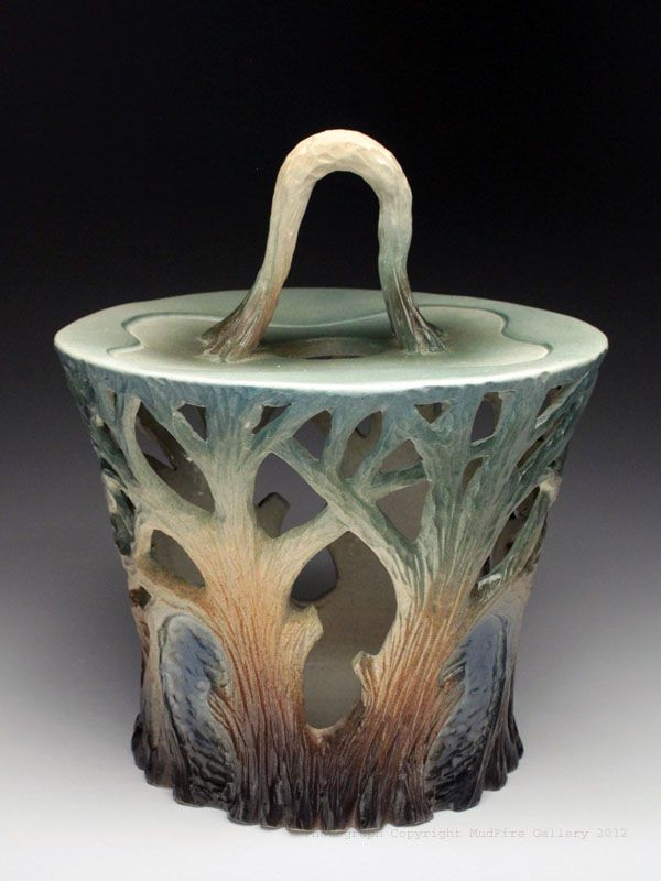 Dow Redcorn does this lyrical carving, his pitchers and mugs are wonderful.