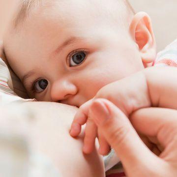 beautiful-breastfeeding-baby-holding-moms-hand_700x700_shutterstock_118667500.jpg
