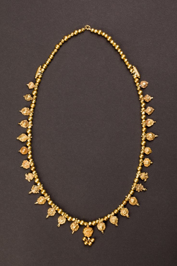 Central India   Maharashtra Gold wedding necklace with twenty-nine pendants, each with a different symbolic and propitiatory meaning.   Reference; Oppi Untracht, Traditional Jewelry of India, New York, 1997, p. 233   ca. beginning of 1900s   22k gold