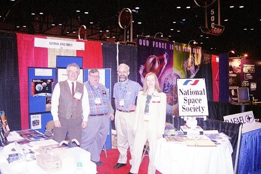 The National Space Society booth at the 2002 World Space Congress. Left to right: CSSS Jim Plaxco, Larry Ahearn, Bruce MacKenzie, Marianne Dyson.