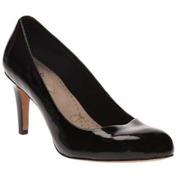 Make a statement while looking effortless in a pair of mid-height court shoes in Black patent. This simple style adds a touch of elegance to any outfit and with Cushion Soft technology it's the perfect versatile shoe to take you from day to night. http://www.marshallshoes.co.uk/womens-c2/clarks-womens-carlita-cove-black-patent-court-shoes-p3635