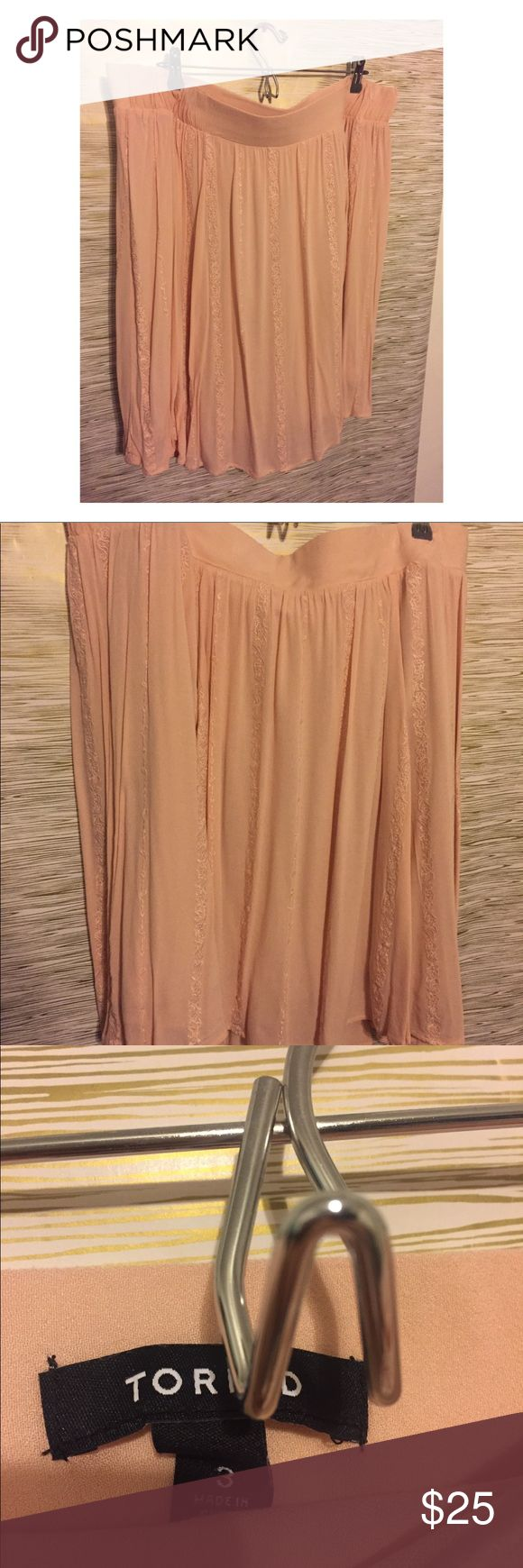 Torrid pink detail skirt Size 3 torrid skirt. Pink. With a cute detail around the skirt. Worn only once. Super comfortable and figure flattering. Perfect for those beautiful sunny days. The skirt band itself is very giving and comfortable. Pet and smoke free home. Please feel ask questions! torrid Skirts