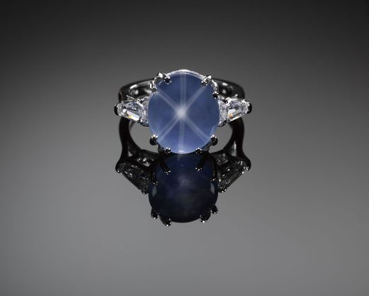 Platinum ring with blue star sapphire and diamonds