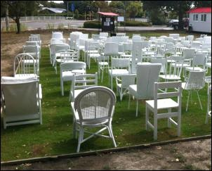 where Oxford Terrace Baptist Church once stood, 185 empty white chairs the vacant site.