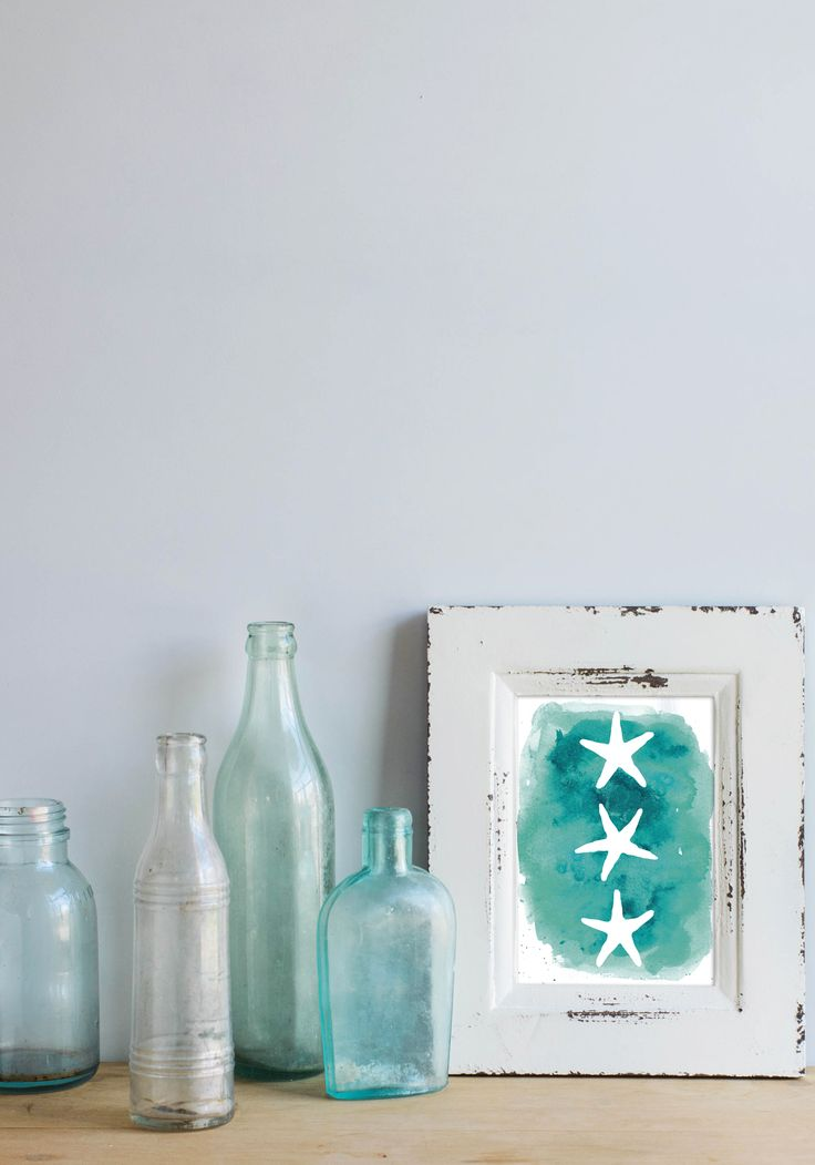 This starfish trio is set on a beautiful aqua blue watercolor background, emulating the feel of the ocean. It will make your home, office or nursery feel like a coastal oasis!