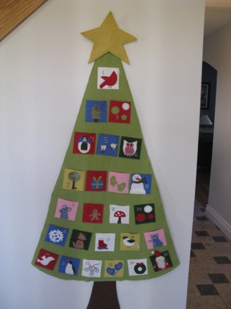 "The Advent Calendar that I made in 2008.  I need to fix the floppy star this year.  I want to add a little ""character"" to move from pocket to pocket each day.  I saw a little Santa guy, but hmm...thinking of something else though maybe.  Need to brainstorm."