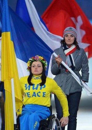 Flagbearer and Cross Country skier Lyudmyla Pavlenko of Ukraine enters the stadium.