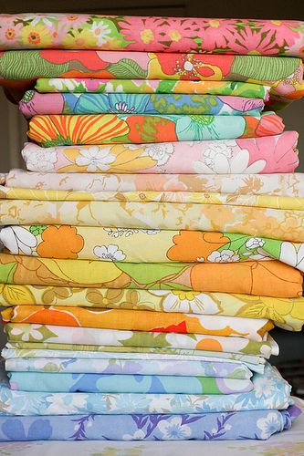 "Flower power bed linen...My Mom has the 6th one down in blue that she made into a blanket...we refer to it as the ""Granny Blanket"" still use it till this day when at her house, my kids now my grandkids."