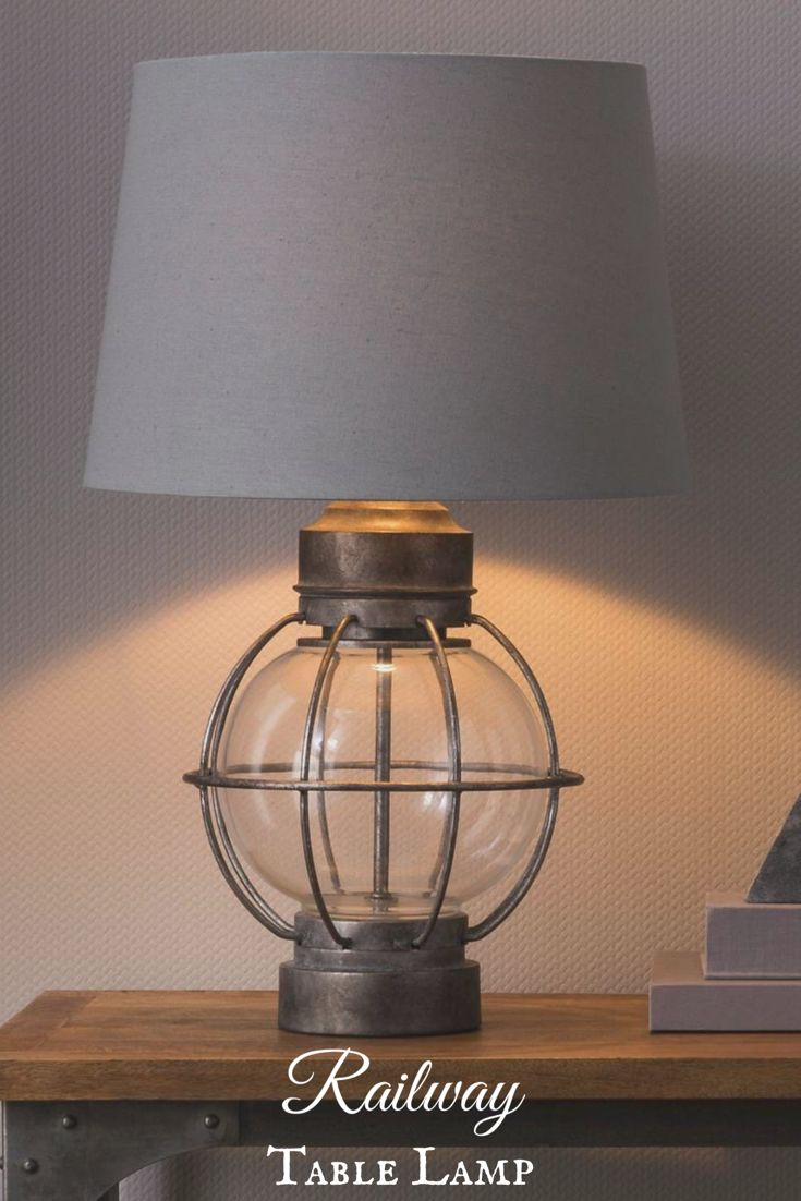 Beekman 1802 FarmHouse Railway Table Lamp - Metal and glass Inspired by railroad lanternsThe Railway Table Lamp in Grey from Beekman 1802 FarmHouse was inspired by the railway line that used to run between New York City and Sharon Springs, NY. The lamp has classic appeal but fits marvelously in a modern setting. #farmhouse #farmhousestyle #farmhousedecor #TableLamps #lamp #ad