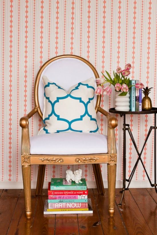 Pretty chair, pretty wallpaper, pretty books...............