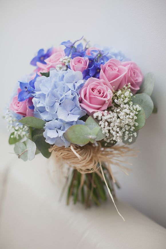 Country garden bouquet featuring pale blue hydrangeas, pink roses and eucalyptus. Photography by www.hayleysavagephotography.co.uk