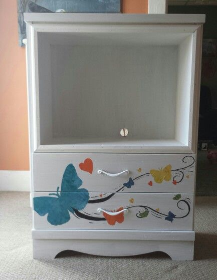 Dresser makeover... TV Stand. Decoupage butterflies make this oh so cute.
