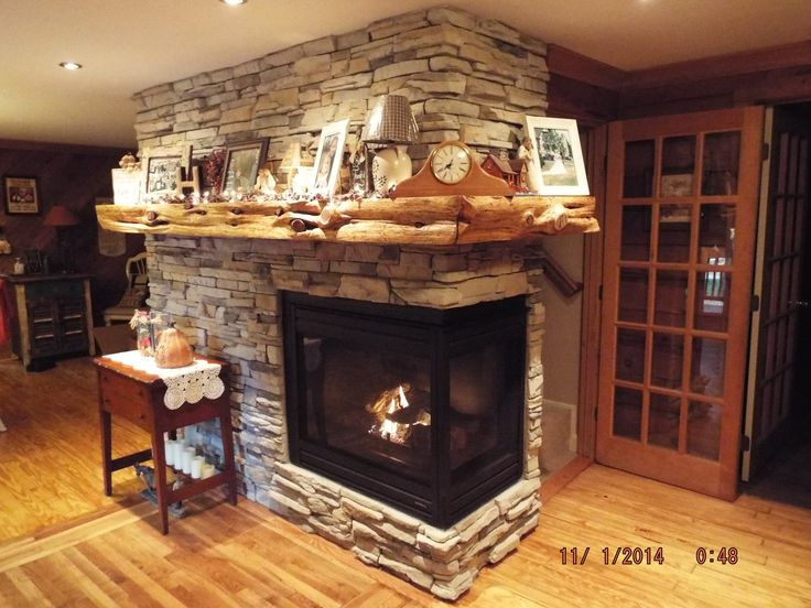 Fireplace remodel with two sided fireplace and cedar tree for mantel  For the Home  Farmhouse