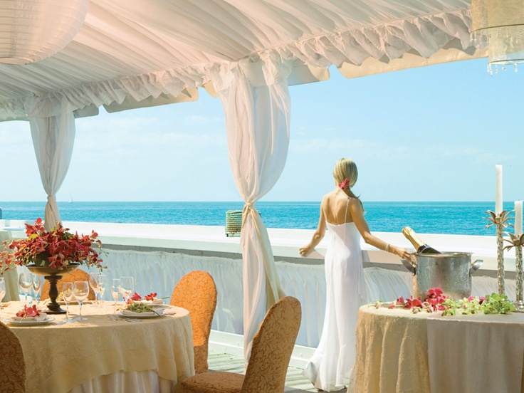 Wedding Reception on Sunset Pier at Ocean Key Resort & Spa in Florida. Just join Stash Rewards and you are on your way!