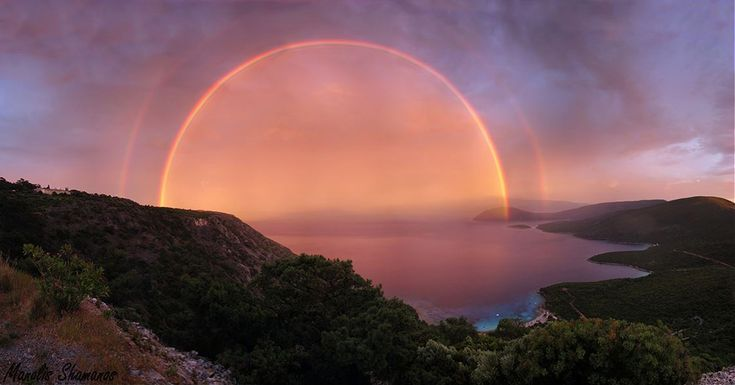Spectacular image of a double rainbow looks like a magic portal. The Earth Science Picture of the Day is featuring this spectacular photo of a double rainbow at the end of a stormy day. It was taken last April by Manolis Shamanos at sunset, in the island of Samos, Greece. It really looks like some kind of supernatural phenomenon.