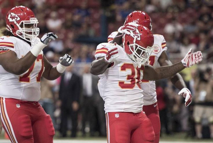 Kansas City Chiefs defensive end Mike Catapano (77), Kansas City Chiefs cornerback Jamell Fleming (30) and Kansas City Chiefs wide receiver Chris Conley (17) celebrated a touchdown by Fleming in the first quarter during the Kansas City Chiefs and St. Louis Rams football game in the Edward Jones Dome on Thursday, September 3, 2015, in St. Louis, Missouri.