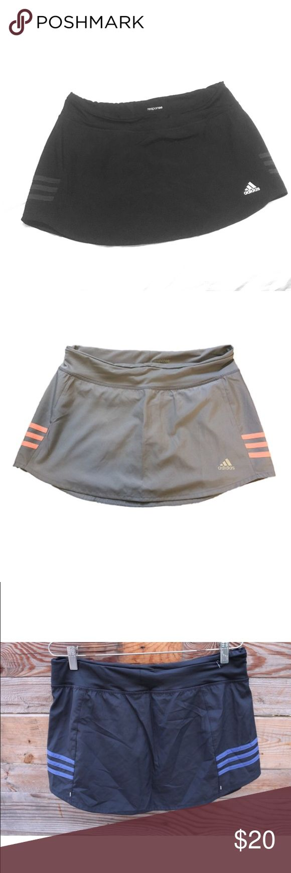 Adidas Response Tennis Fitness Skort NWOT. Purchased the wrong size. Stretchy shorts underneath. Black with dark blue (navy) stripes on side. Adidas Shorts Skorts