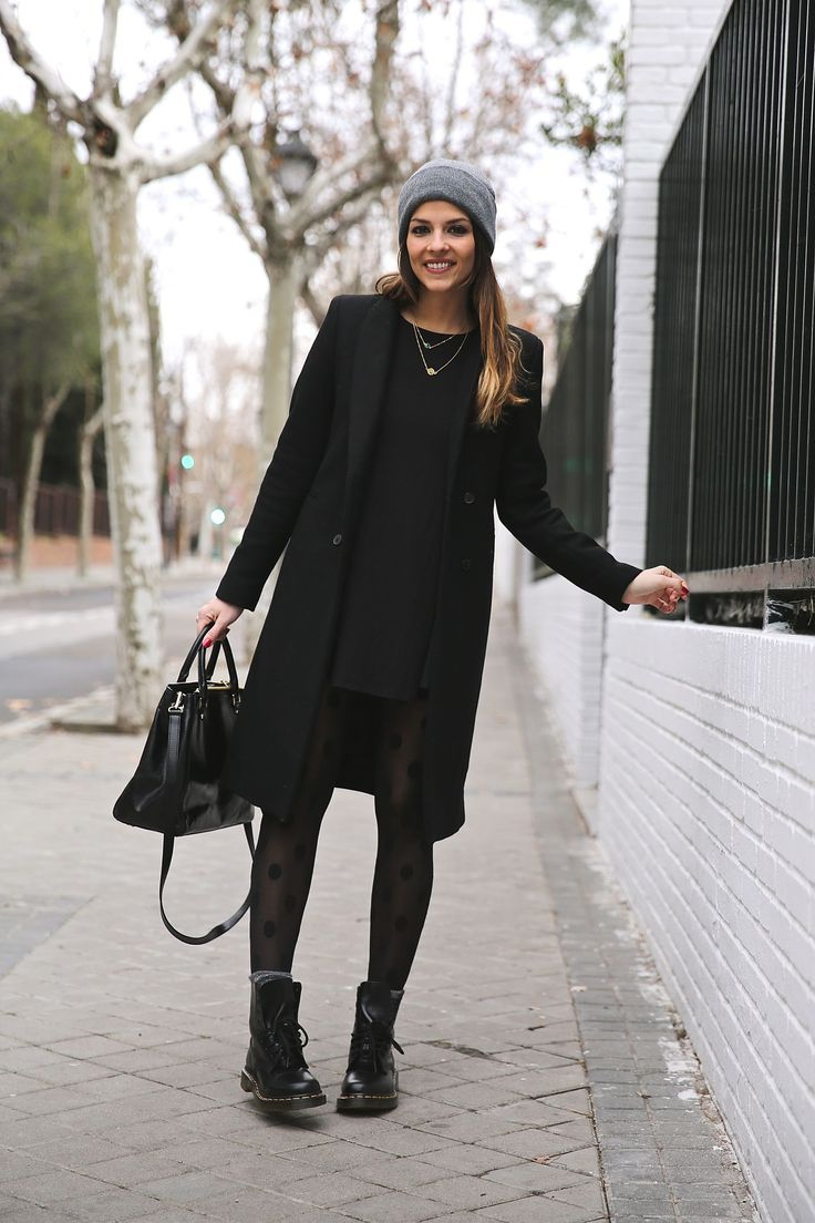 Natalia Cabezas is wearing a black dress and coat from Zara, boots from Dr. Martens, bag from Michael Kors and the hat is from Asos