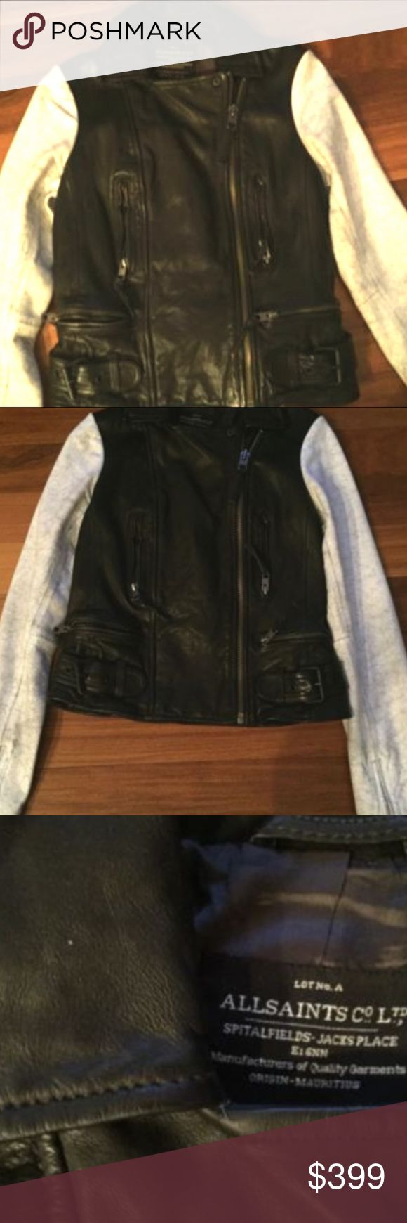 AllSaints Leather Jacket Blk & White Distressed 4 New without tags authentic ALLSAINTS distressed leather biker jacket in US size 4. It is a very rare style that features off center zip and extra distressed white zippered sleeves. It is very striking and flattering. This jacket has great details: Zip Sleeves Two front vertical pockets with Zip Buckles at bottom of each side with horizontal zip pockets just above them All Saints Jackets & Coats