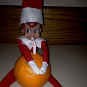 "elf on the shelf   drinking ""orange juice"""