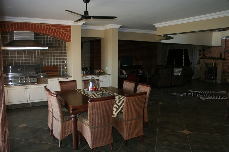 $739000. Property 16. Dining room with built in gas barbeque, onto open plan lounge, and kitchen