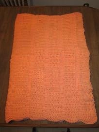 """Crocheted """"Cable"""" stitch afghan, peach coloured, 100% Acrylic yarn. Very heavy and warm.  66"""" long x 48"""" wide.  Machine wash warm or cold on """"gentle"""" cycle. Dry on a """"low"""" setting. Do not hang to dry, this causes stretching. May be laid flat to d..."""