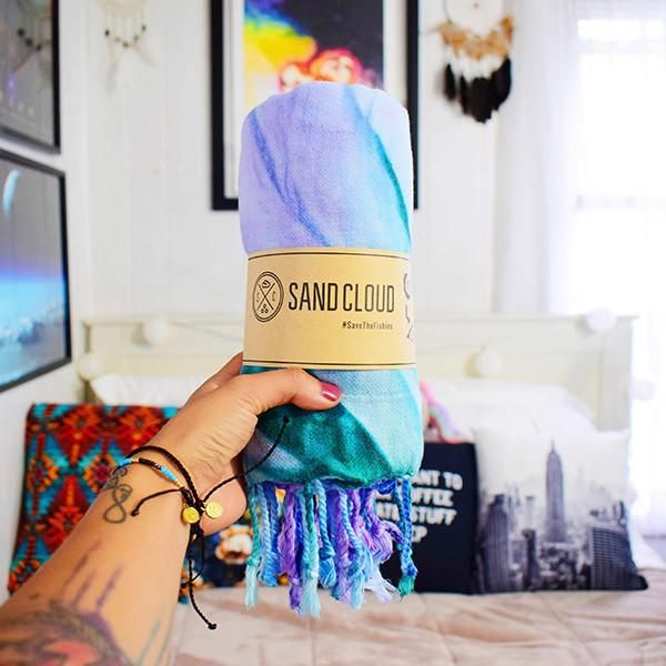 """This Luna Tie Dye Beach Towel will be the grooviest towel at any beach, festival, or park. This towel is the definition of """"Peace, Love, and Good Vibes."""" With its radical patterns you are totally ready to kick back and have a great time!"""