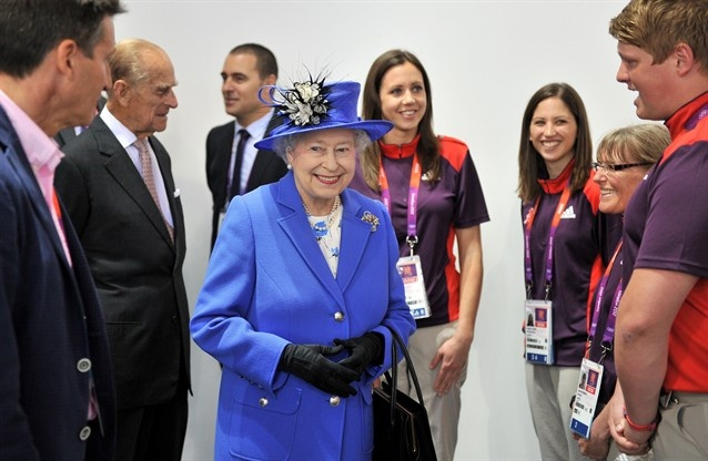 Royals At Olympic Events - Slideshows | Queen Elizabeth II and Prince Philip, Duke of Edinburgh take in swimming at the Aquatic Centre on Day 1 of the Olympics.  (Photo: WPA Pool / Getty Images) #NBCOlympics