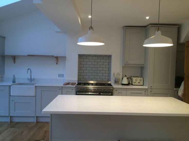 Benchmarx Kitchen, Quartz worktop, butler sink, oak floor, grey kitchen